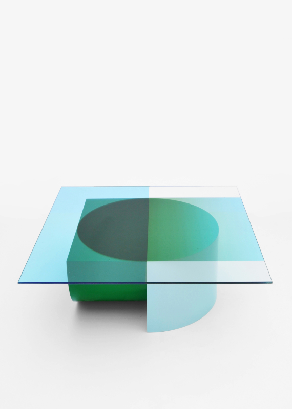 Design forward and beautiful low table for your home interior. COMPOSITION is a low table where the transparant colours of the glass top become more saturated or change colour where they overlap the base. The graphic design of the glass top follows the geometric shapes of the base. Colorful lowtable with a contemporary design. Available in various color combinations. Shipping worldwide. Made to order. A design that adds value to every modern and contemporary home and interior.